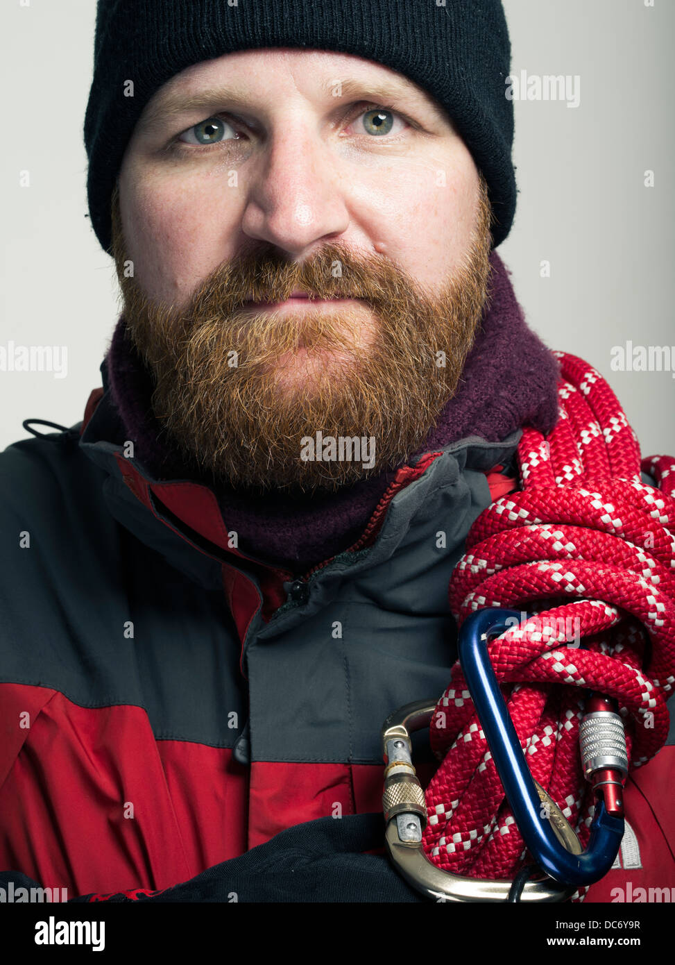 Mountain Rescue Worker with mountain jacket carabineers climbing rope - Stock Image