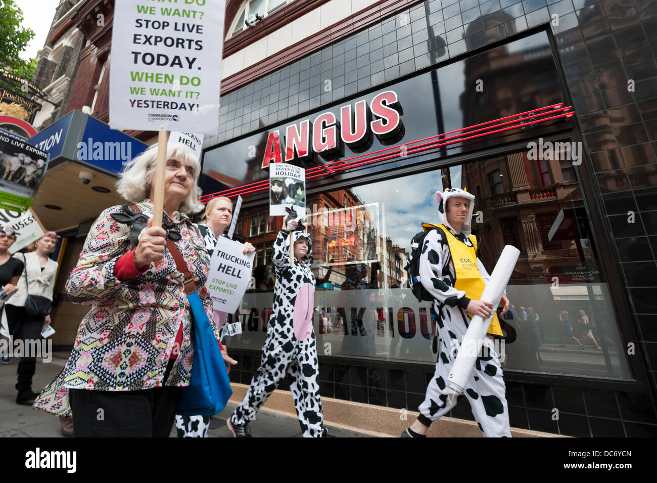 London, UK, 10th August, 2013. Compassion in World Farming supporters protest in Covent Garden in central London - Stock Image