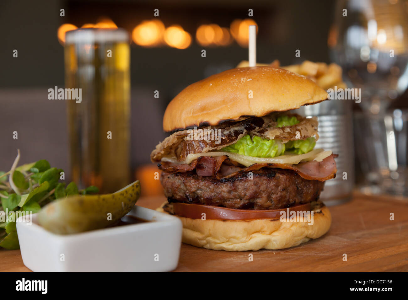 Gourmet burger and cold lager in contemporary gastropub - Stock Image