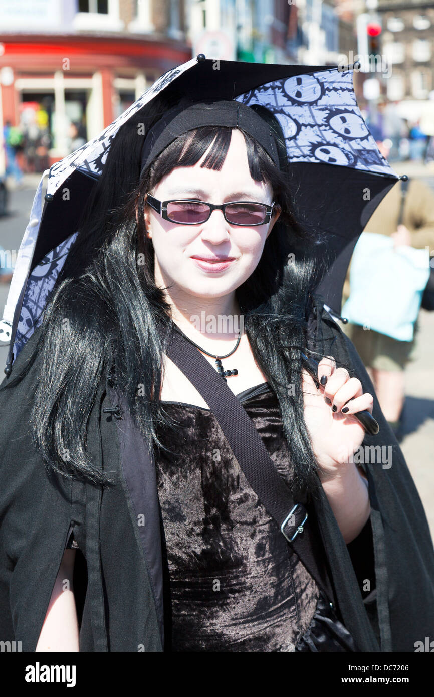 Teen heavy metal fan with umbrella posing emo goth gothic in Whitby  Yorkshire UK England -