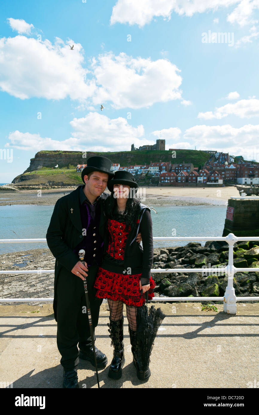 Teen heavy metal fans with top hats posing emo goth Gothic in Whitby Yorkshire UK England - Stock Image