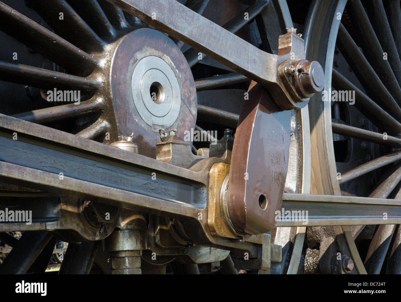 detail of driving rod mechanism on old steam locomotive - Stock Image
