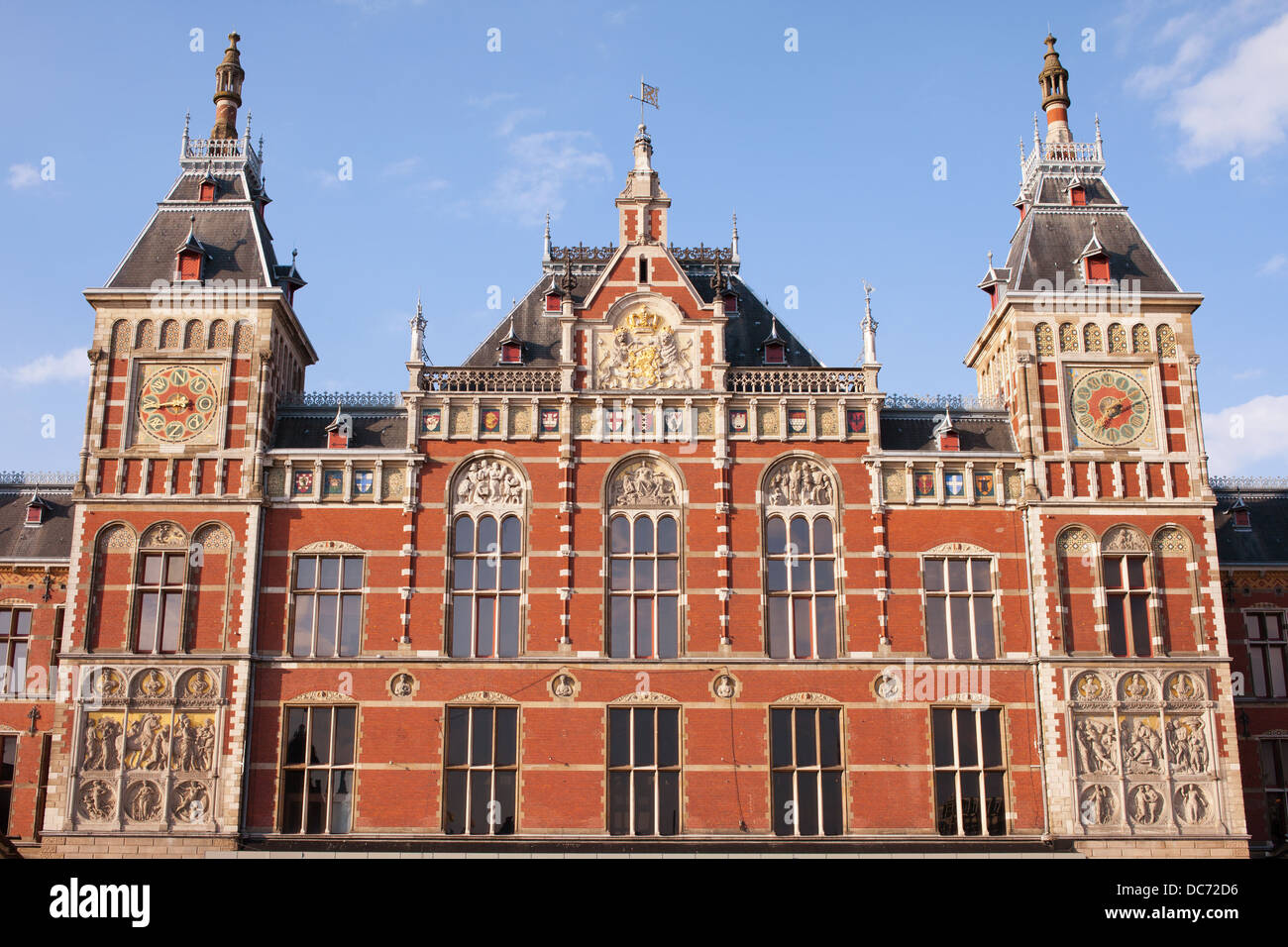 Amsterdam Central Train Station facade in Holland, Netherlands, 19th century Neo-Renaissance and Neo-Gothic style. - Stock Image