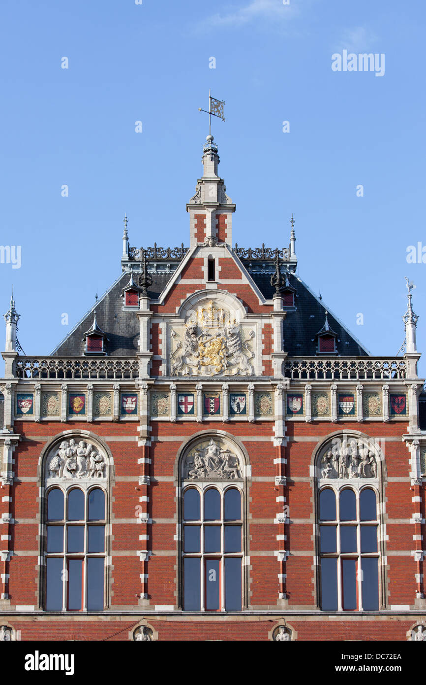 Amsterdam Central Station architectural details in Holland, Netherlands, 19th century Neo-Renaissance and Neo-Gothic - Stock Image