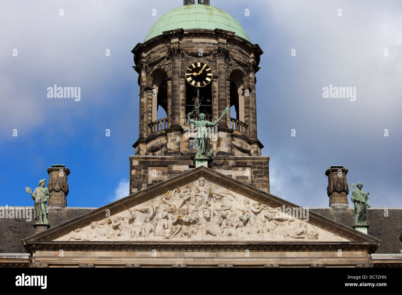 Pediment and Tower of the Royal Palace (Dutch: Koninklijk Paleis) in Amsterdam, Netherlands, 17th century classical - Stock Image