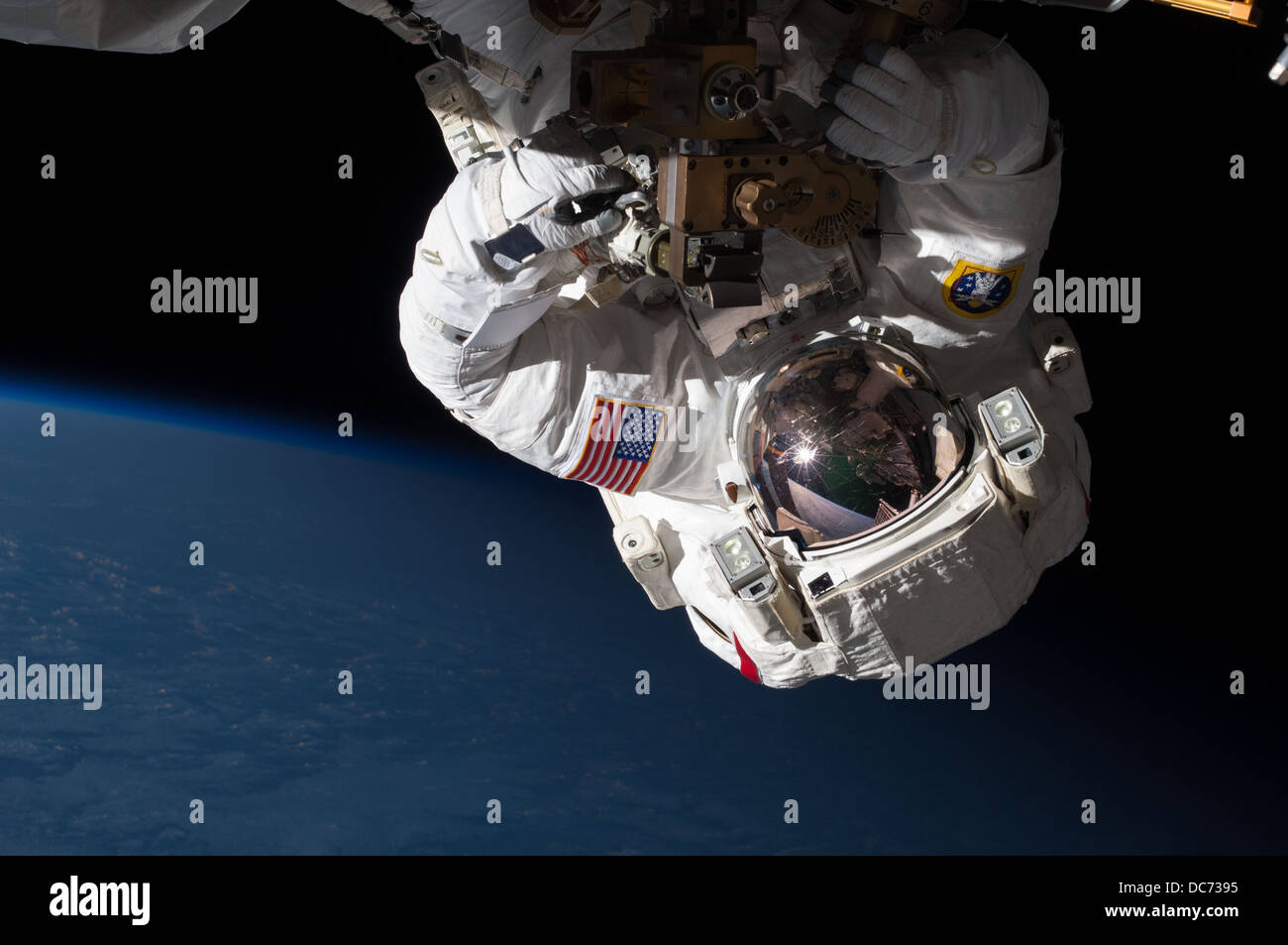 NASA Expedition 35 Flight Engineer Chris Cassidy performing a space walk - Stock Image