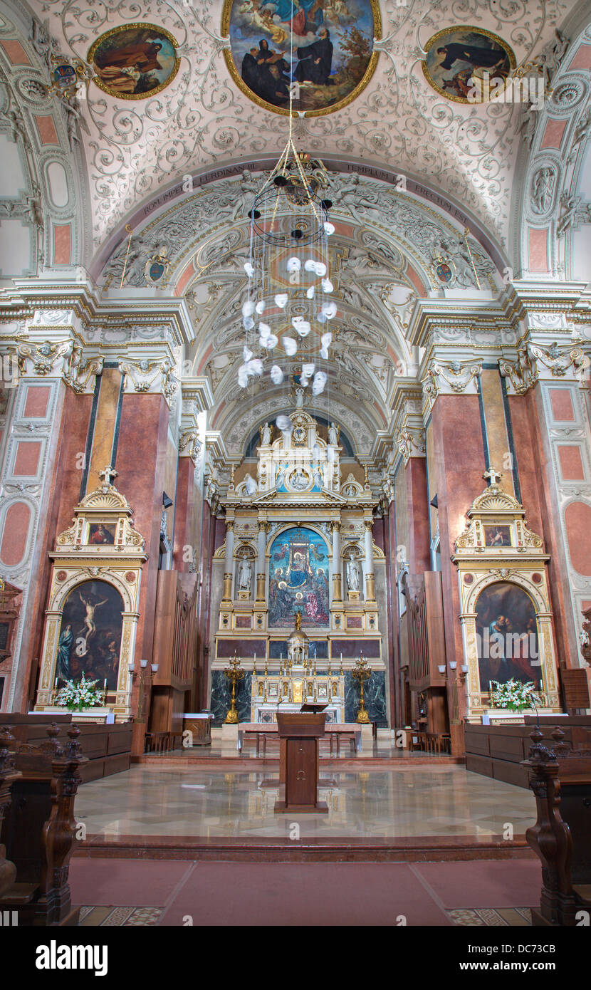 VIENNA - JULY 3: Main altar of Schottenkirche by Heinrich Ferstel with glass mosaic Madonna by Michael Riese - Stock Image