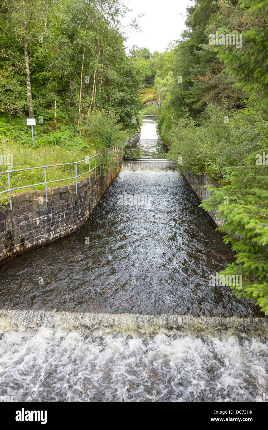 Falls from the Finglas Water Works entering Loch Katrine Trossachs Scotland - Stock Image
