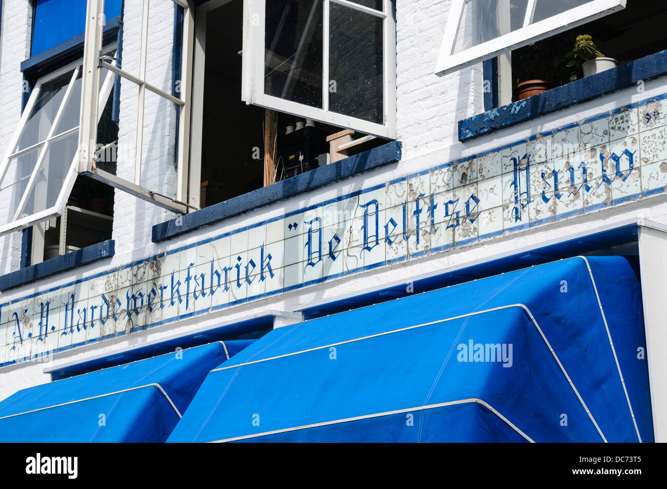 Delft, Netherlands. 5th August 2013 - Sign above the entrance to the Delft Pottery - Stock Image