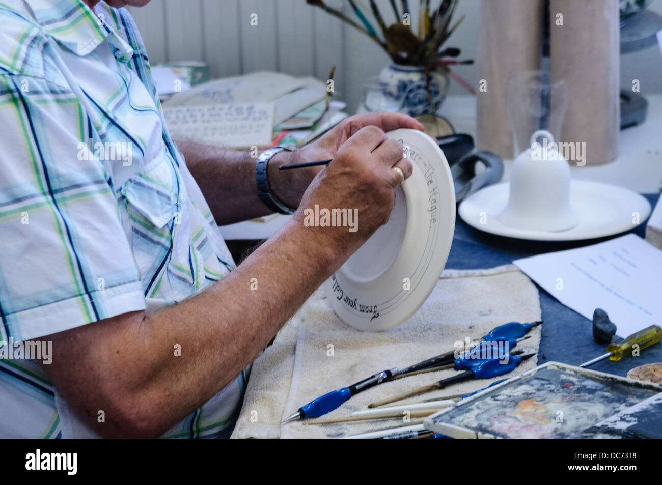 Delft, Netherlands. 5th August 2013 - Potters make and paint traditional blue and white Delft Pottery - Stock Image