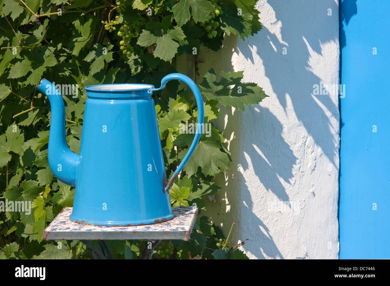 Madam blue enameledl coffee pot - Stock Image