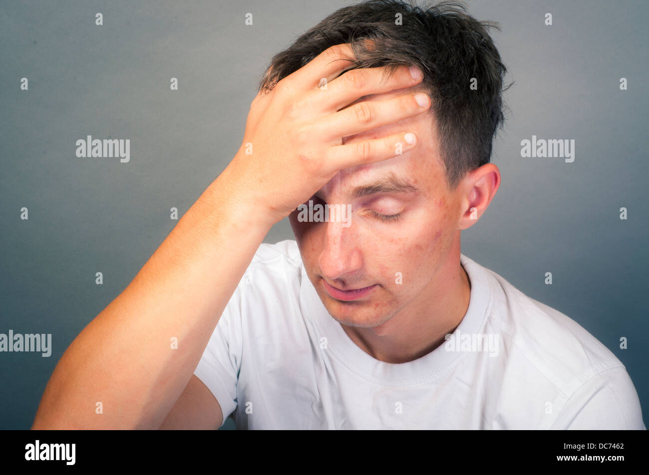 an image of upset young man - Stock Image