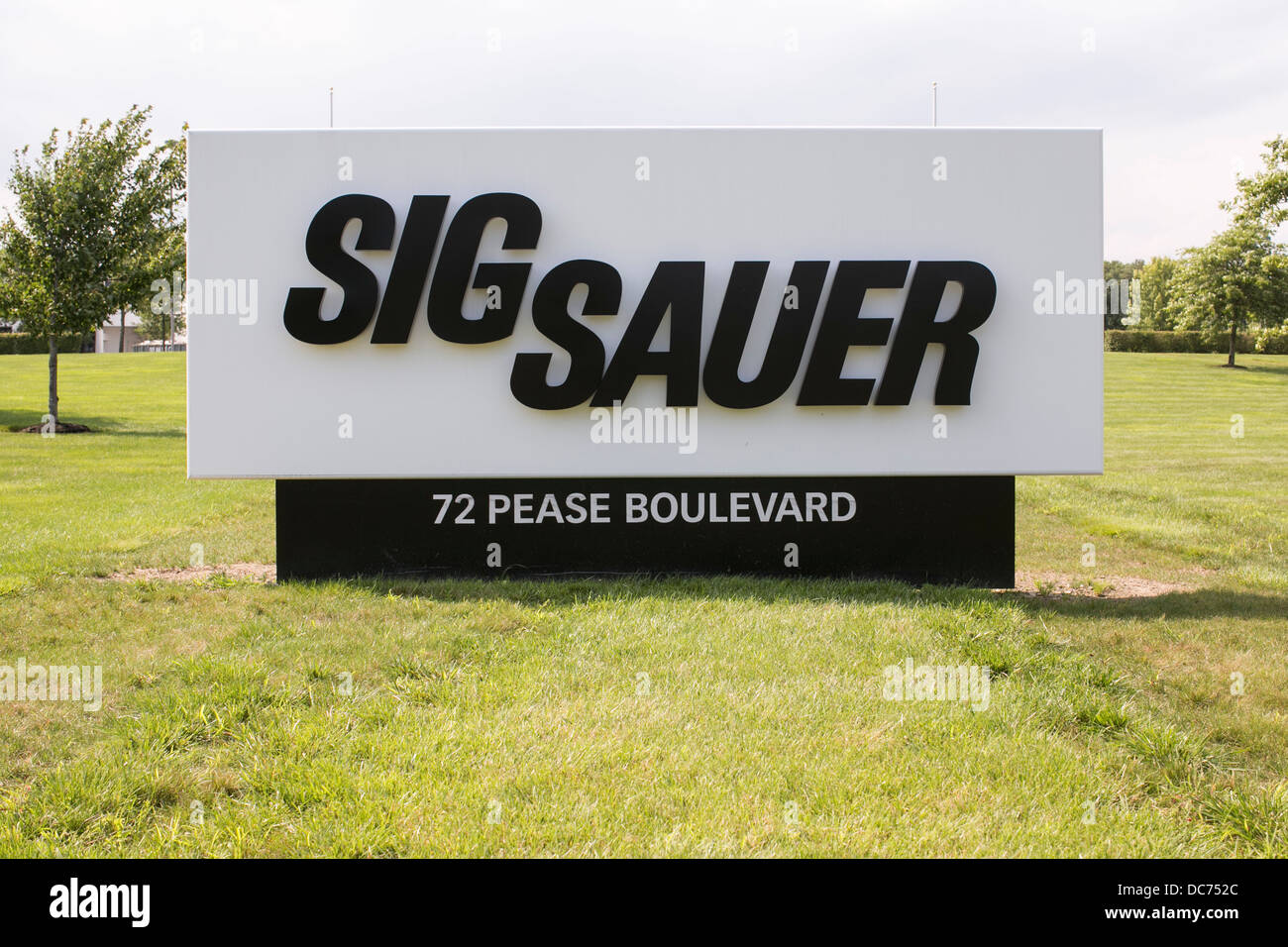 A sign outside of a Sig Sauer firearms manufacturing facility.  Stock Photo