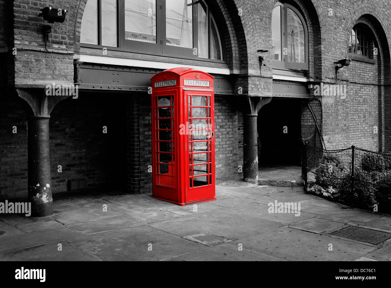 Red telephone box in monochrome image. London UK Example of use of Advanced Filter (partial colour red) of Fujifilm - Stock Image