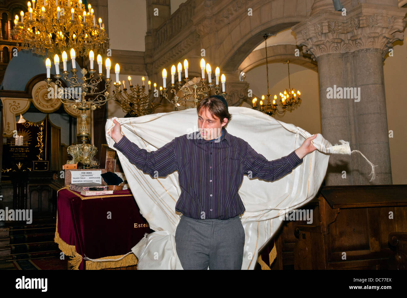 Young Rabbi in a synagogue tells students about the attributes of the Jewish religion, Lyon, France, Europe Stock Photo