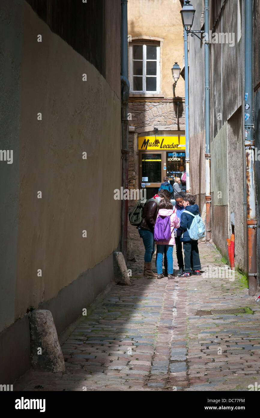 Students discuss something after school in old city, Lyon, France, Europe. - Stock Image