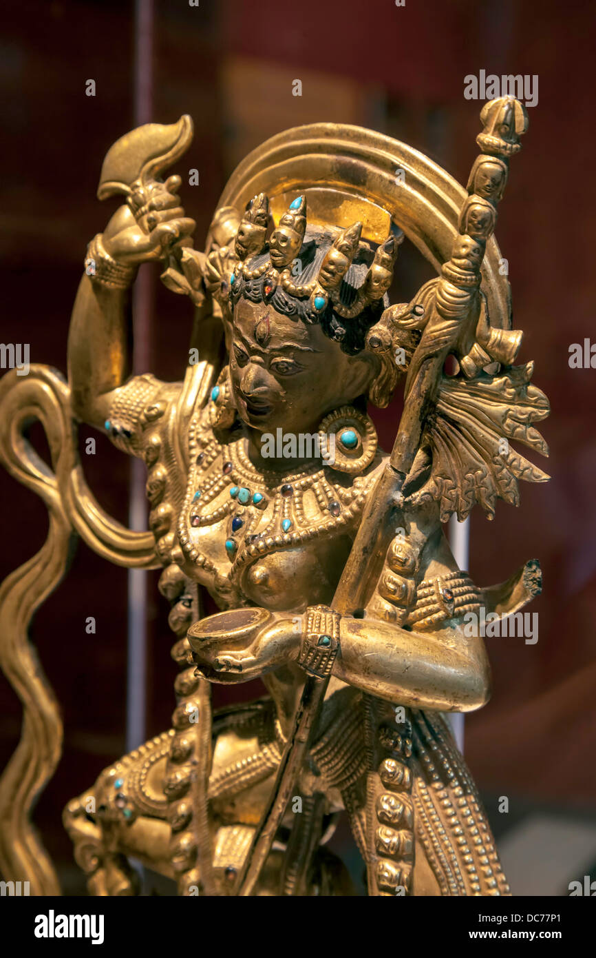 13th century bronze statue of Tibetan god Vajravarahi with gemstones on display in the Cofrin Asian Art wing of - Stock Image