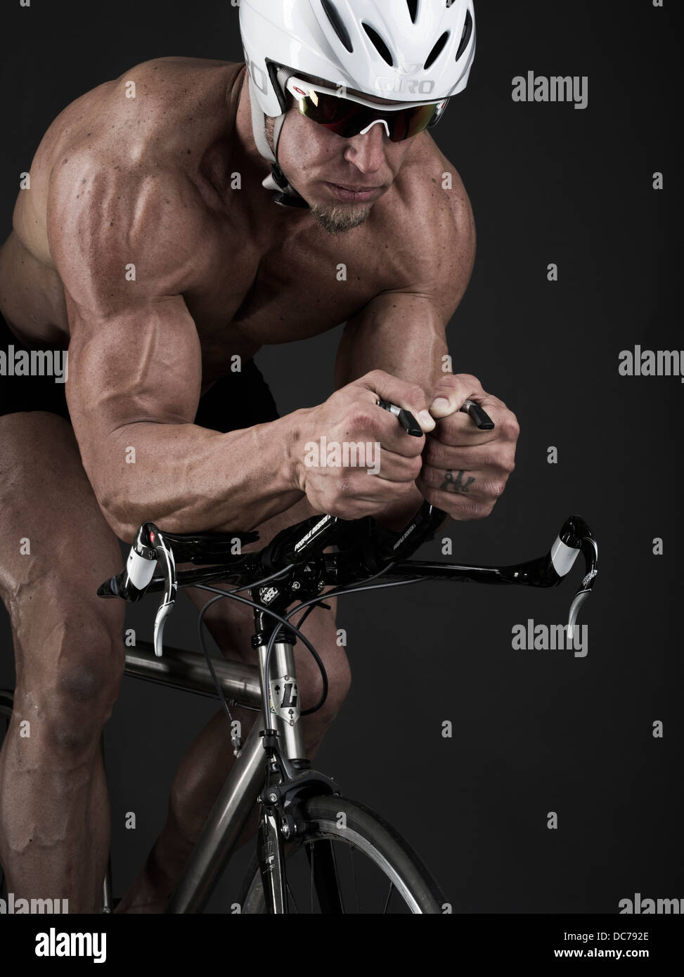 Triathlete time trial racer on bicycle - Stock Image