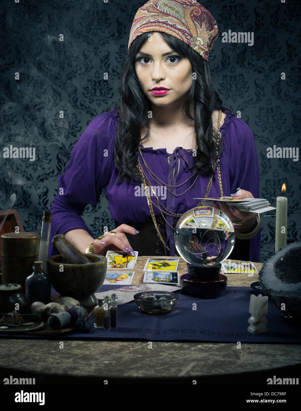 Fortune teller / mystic  with crystal ball and tarrot cards - Stock Image