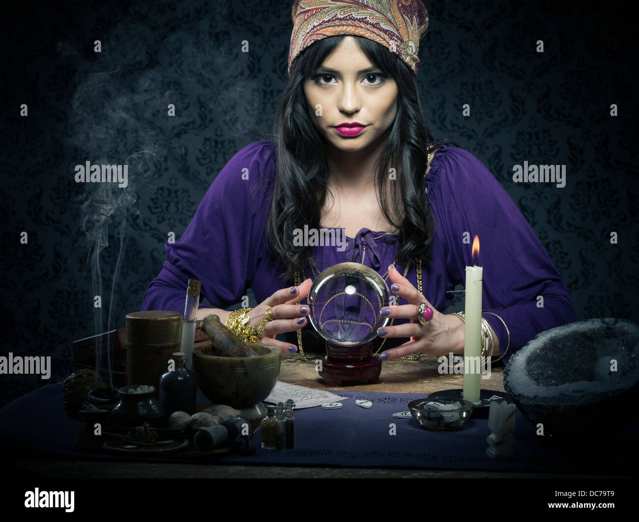 Fortune teller / mystic with crystal ball and tarrot cards