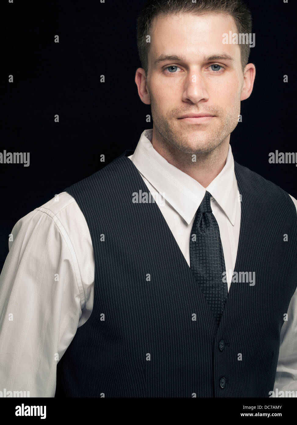 Young businessman white shirt, waistcoat and tie - Stock Image