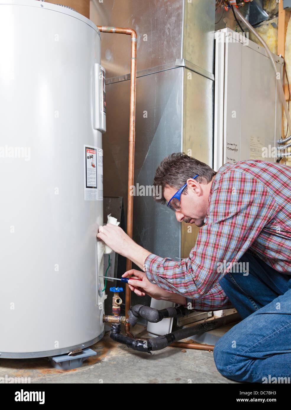 Water heater maintenance - Stock Image