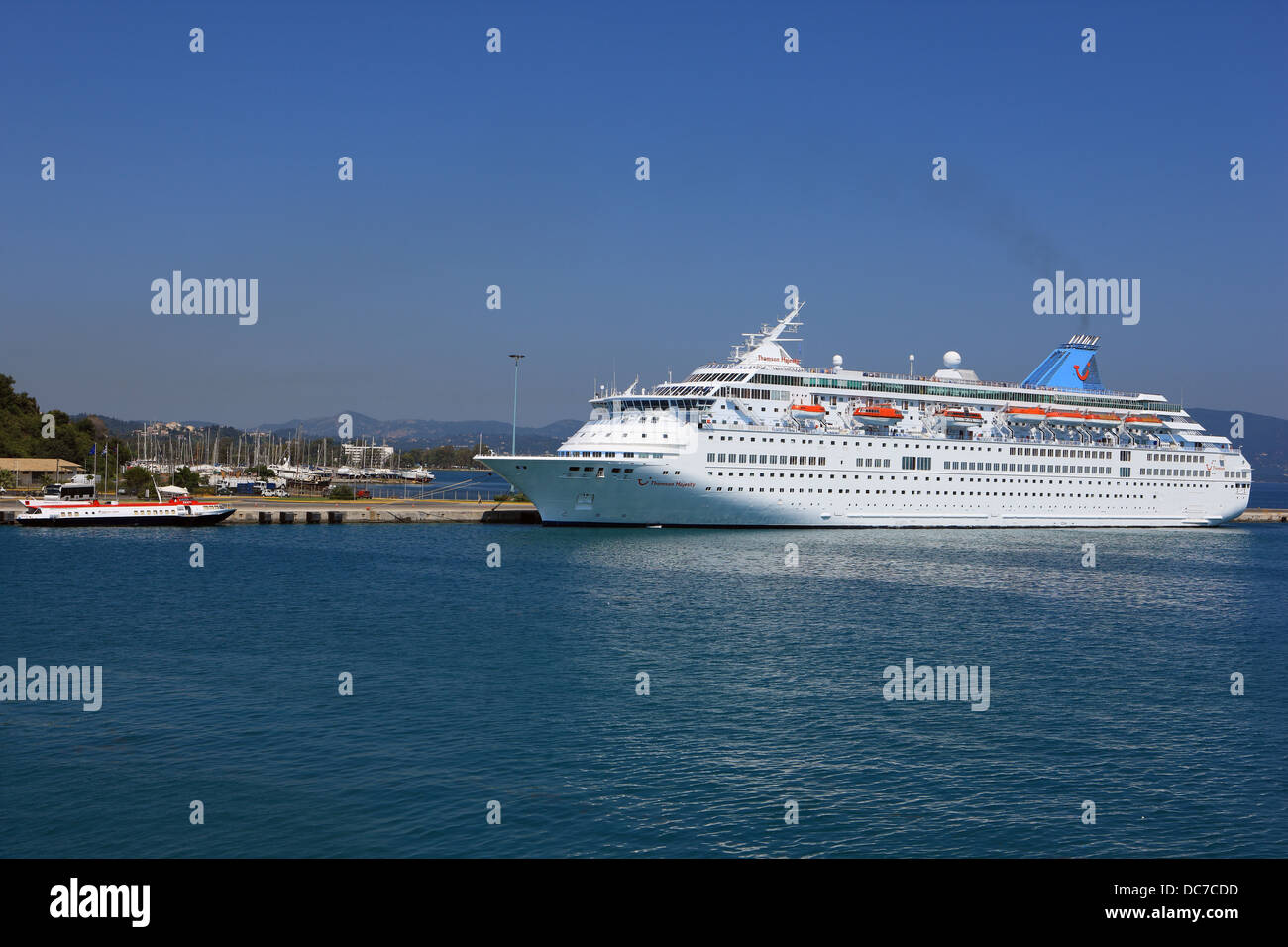 Cruise ship Thomsons Majesty docked in the port at Corfu Town in Greece - Stock Image