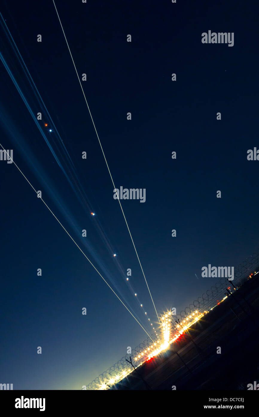 light trail of aircraft while landing - Stock Image