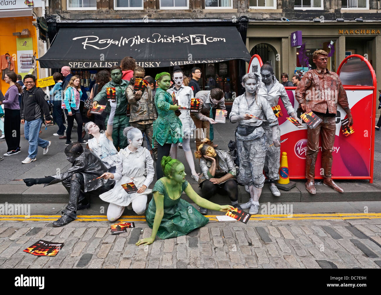 Fringe performers promoting Sentinels show in The Royal Mile Edinburgh during the 2013 Edinburgh Festival Fringe - Stock Image