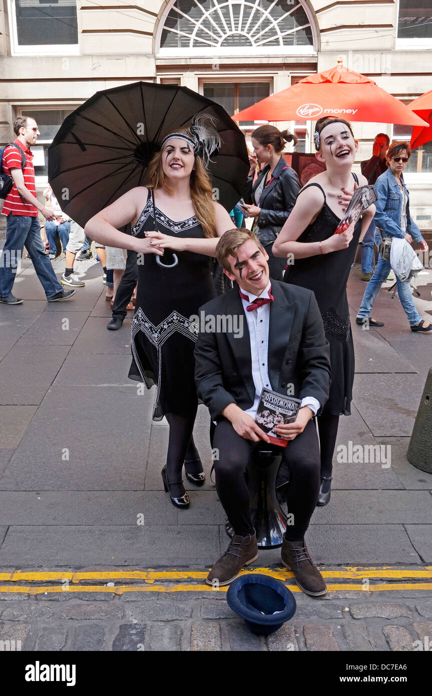 Fringe performers 4Theatre Productions promoting show in The Royal Mile Edinburgh during the 2013 Edinburgh Festival - Stock Image