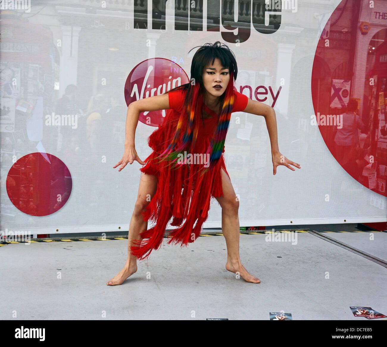 Fringe performer promoting SeKret dance show in The Royal Mile Edinburgh during the 2013 Edinburgh Festival Fringe - Stock Image