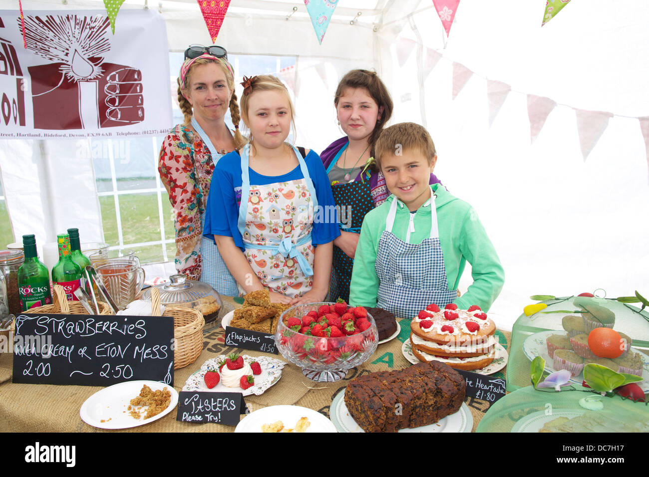 Mums and pupils from the Small School at Hartland N Devon are preparing and selling organic cakes, teas and coffees - Stock Image