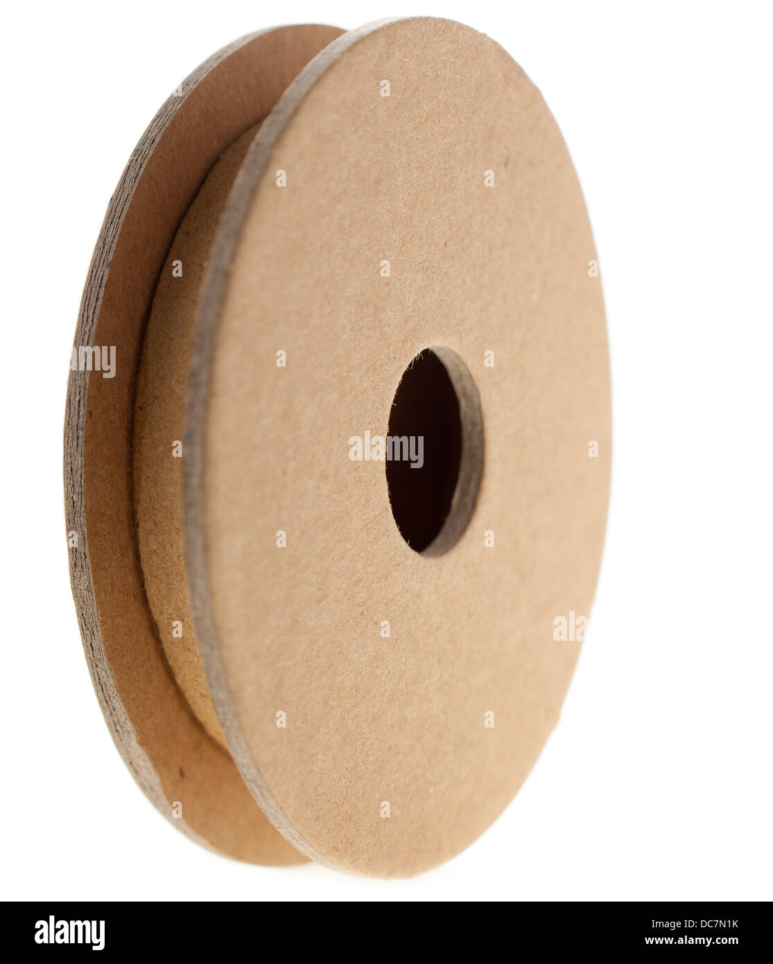 Circular cardboard cable spool for packaging - Stock Image