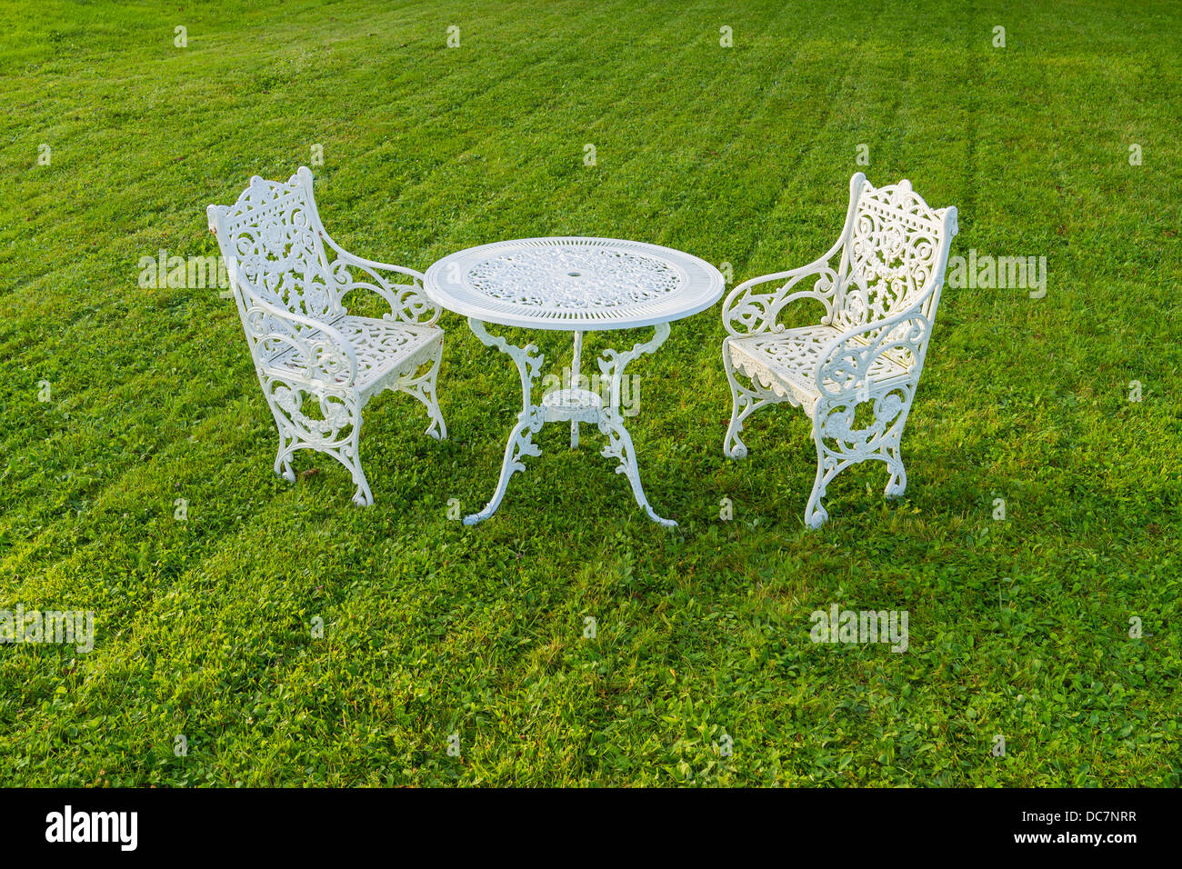 Superb Two White Iron Lawn Chairs White Iron Table On Manicured Caraccident5 Cool Chair Designs And Ideas Caraccident5Info