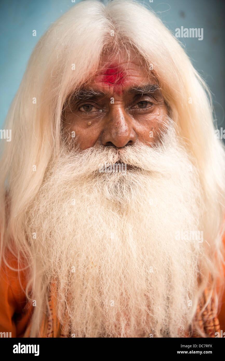 Sadhu, Holy Man sitting by Dashashwamegh Ghat, Varanasi, Uttar Pradesh, India - Stock Image