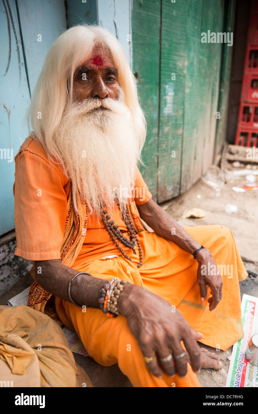 Sadhu, Holy Man sitting by Dashashwamegh Ghat, Varanasi, Uttar Pradesh, India Stock Photo