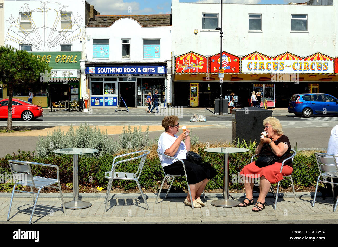 Two elderly ladies sitting eating ice cream on Southend seafront - Stock Image