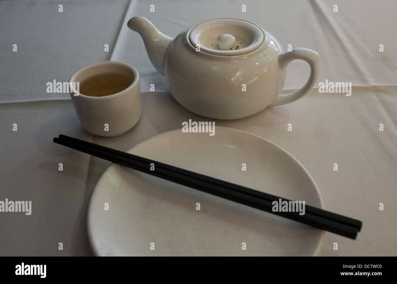 Chinese tea pot and cup with dish and chopsticks - Stock Image