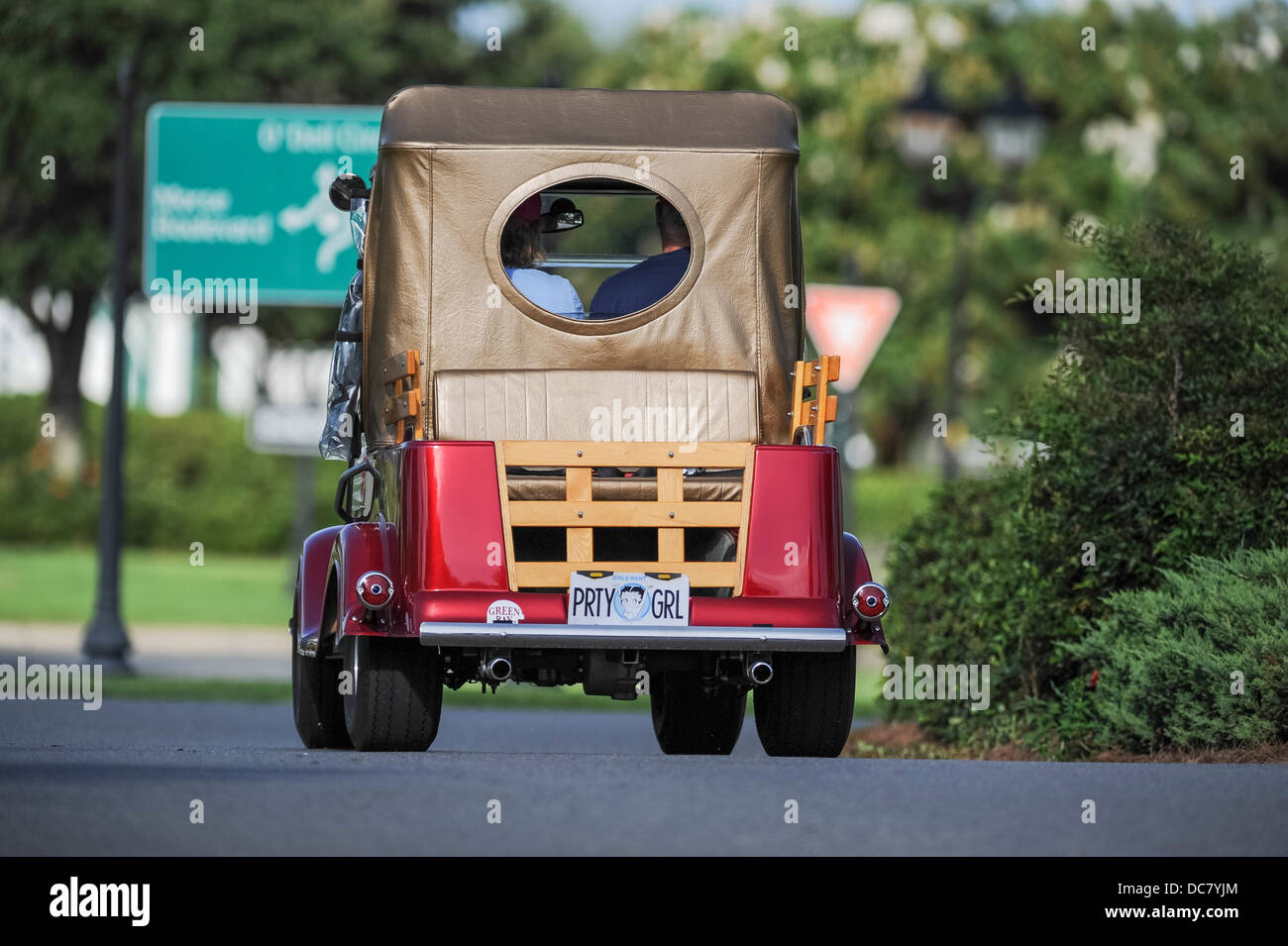 A yesteryear golf cart making it's way down a golf cart path within the Villages, Florida USA - Stock Image