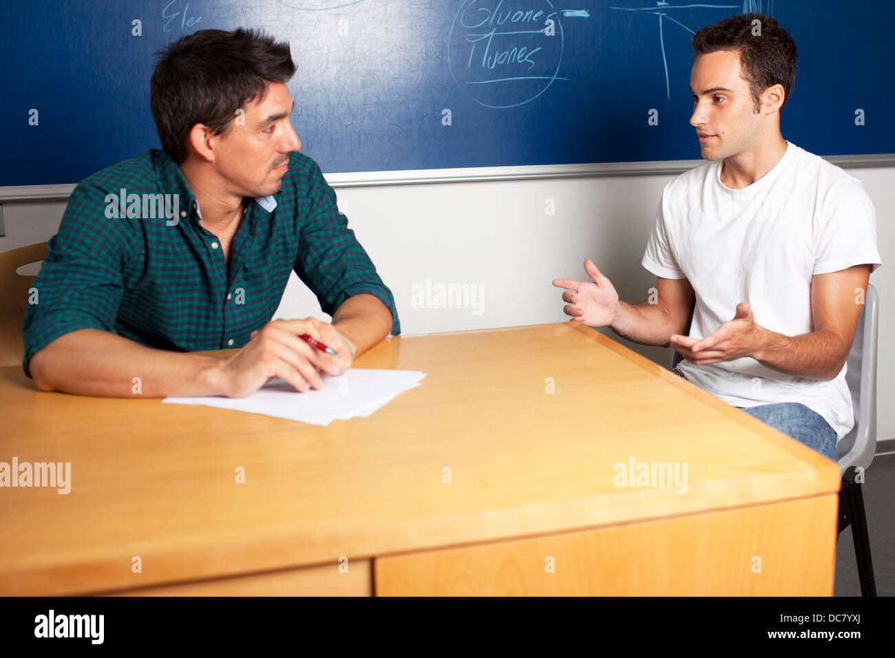 Professor with student in consultation - Stock Image
