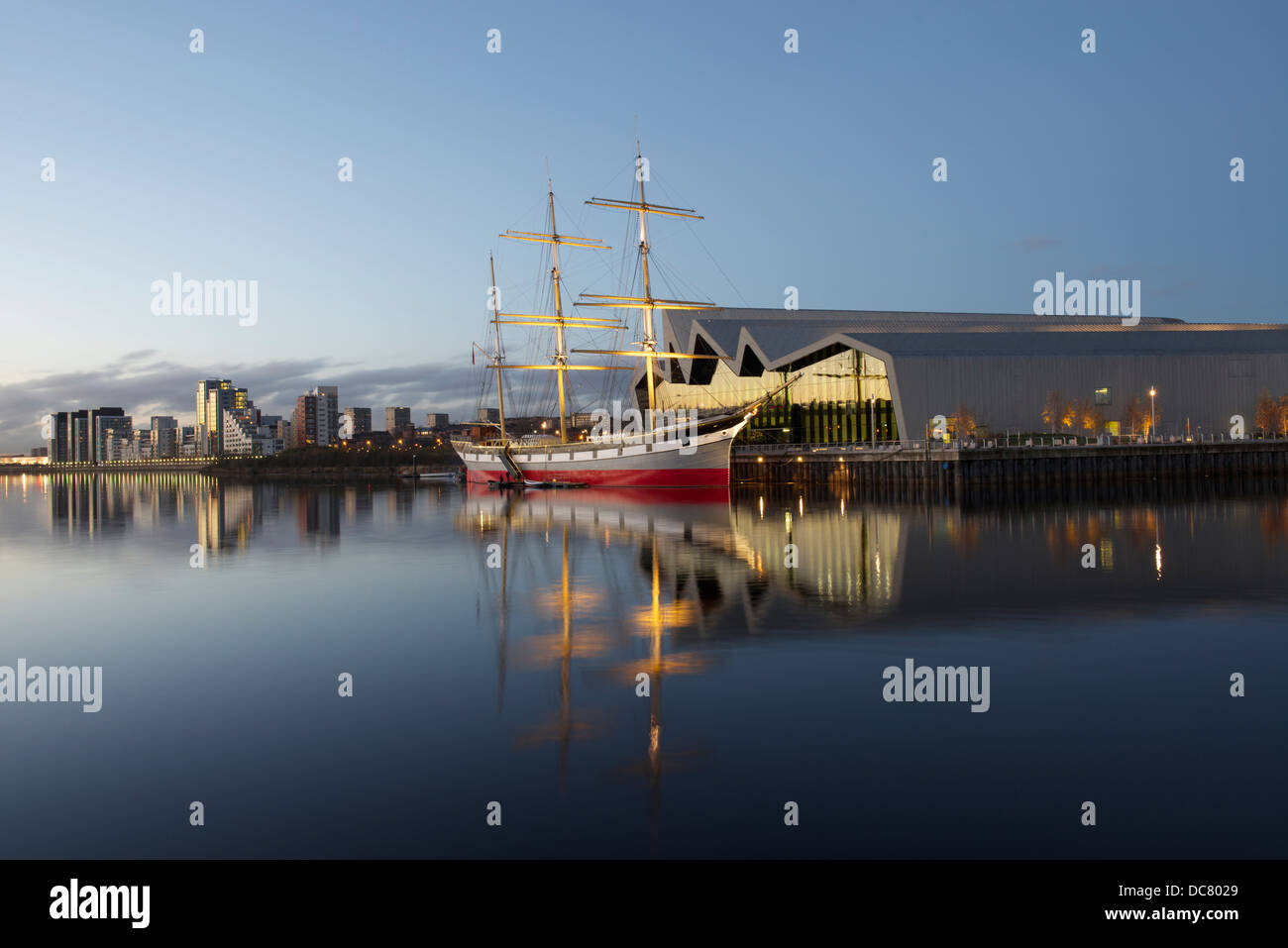 Riverside Museum and the barque, 'Glenlee' on the Clyde with Glasgow Harbour apartments in the distance. - Stock Image