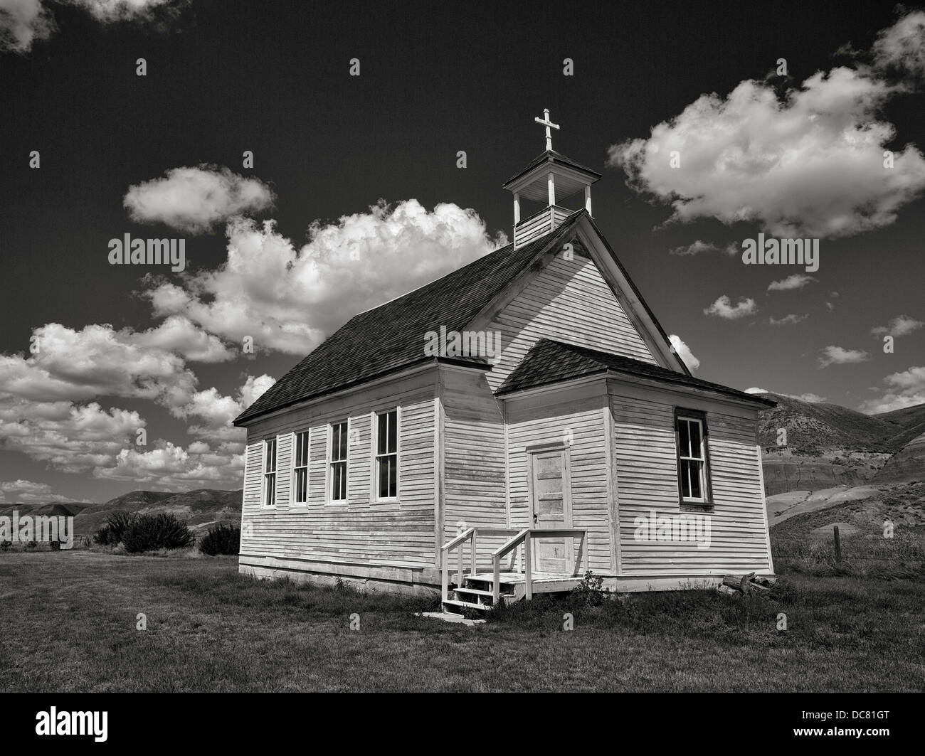 Small church in black and white with cloudy sky in Dorothy, Alberta - Stock Image