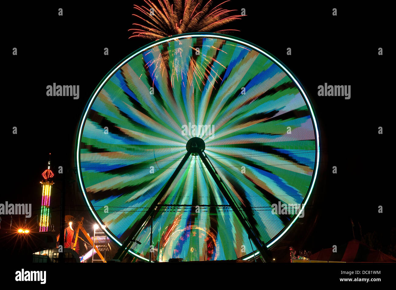 Evergreen State Fair ferris wheel and fireworks - Stock Image