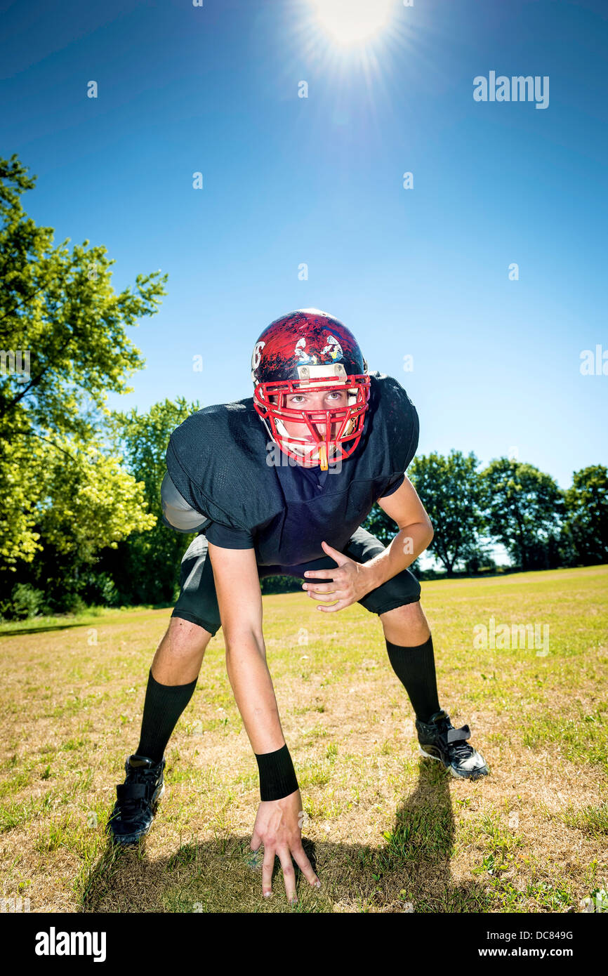 American football player offensive Lineman in three point stance - Stock Image