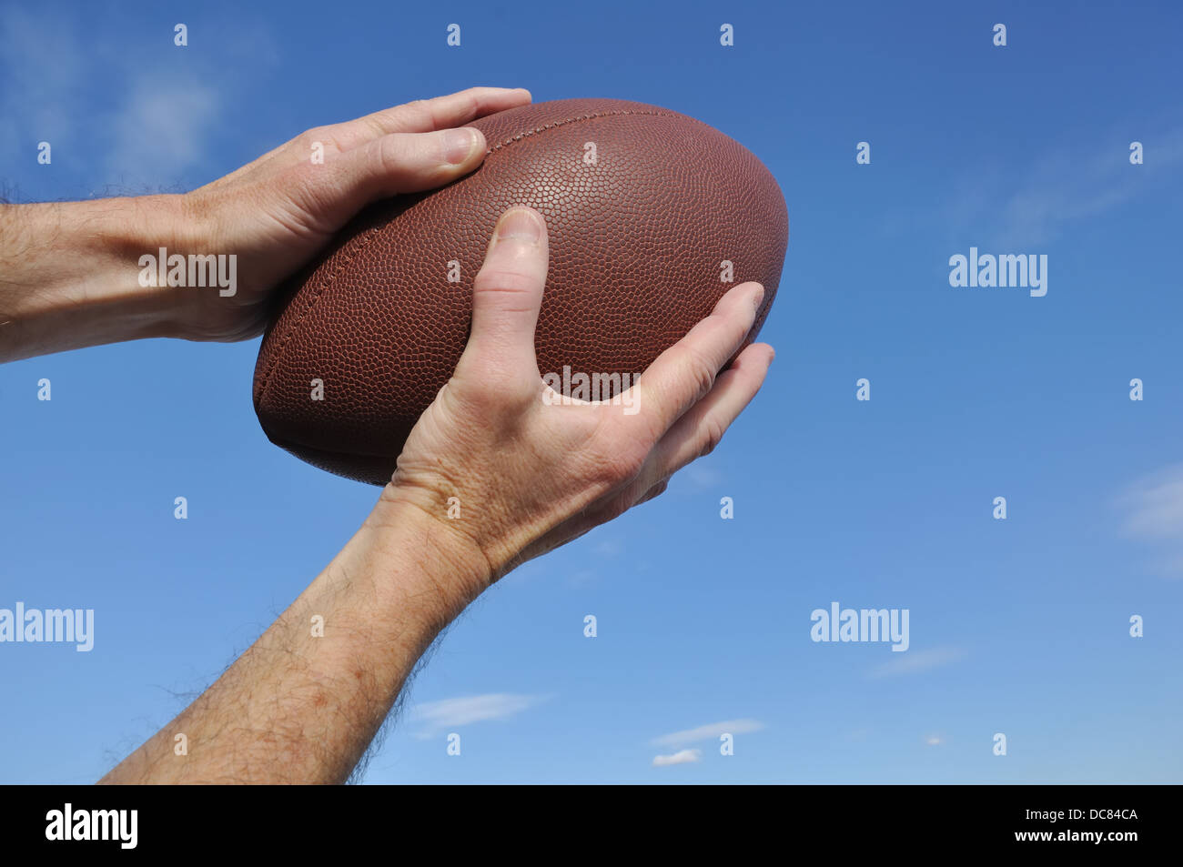 Catching / catcher / receiver holding an American football - Stock Image