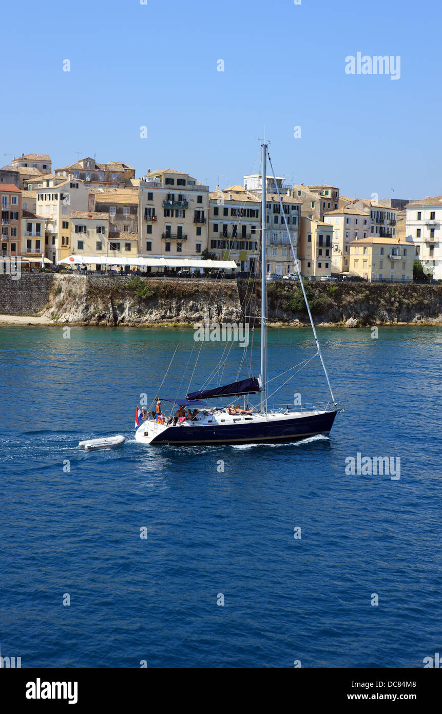 Yacht sailing past Corfu Town in Greece - Stock Image