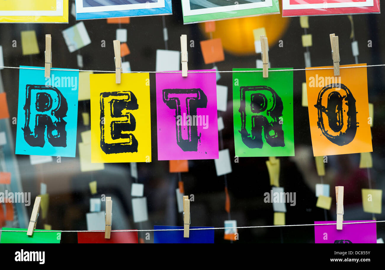Colourful RETRO sign pegged on string in a shop window - Stock Image