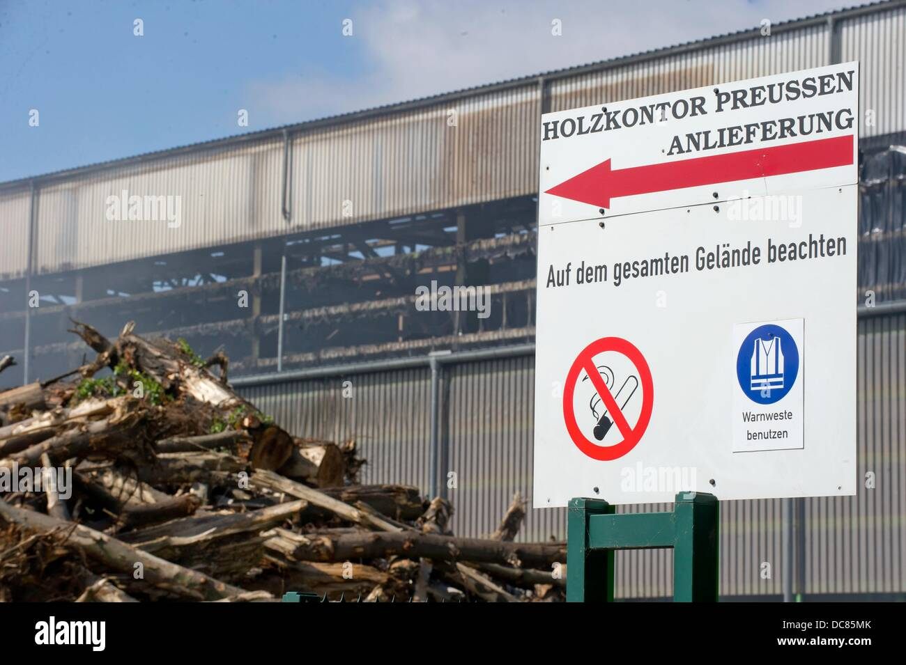 A warning sign that prohibits smoking is seen in front of a smoking hall of a wood recycling plant in Berlin, Germany, - Stock Image