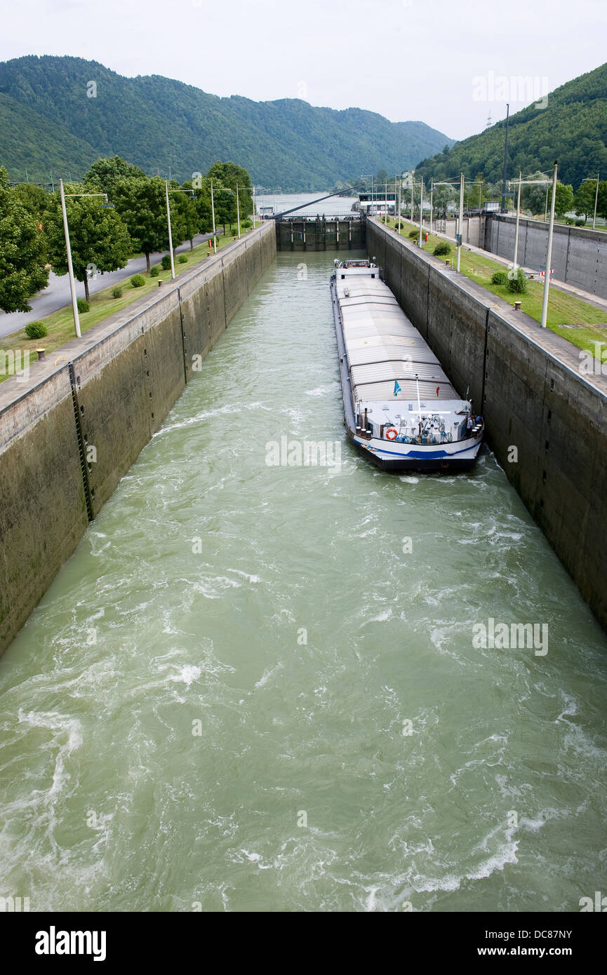 A ship in the sluice of Jochenstein in the Donau river - Stock Image