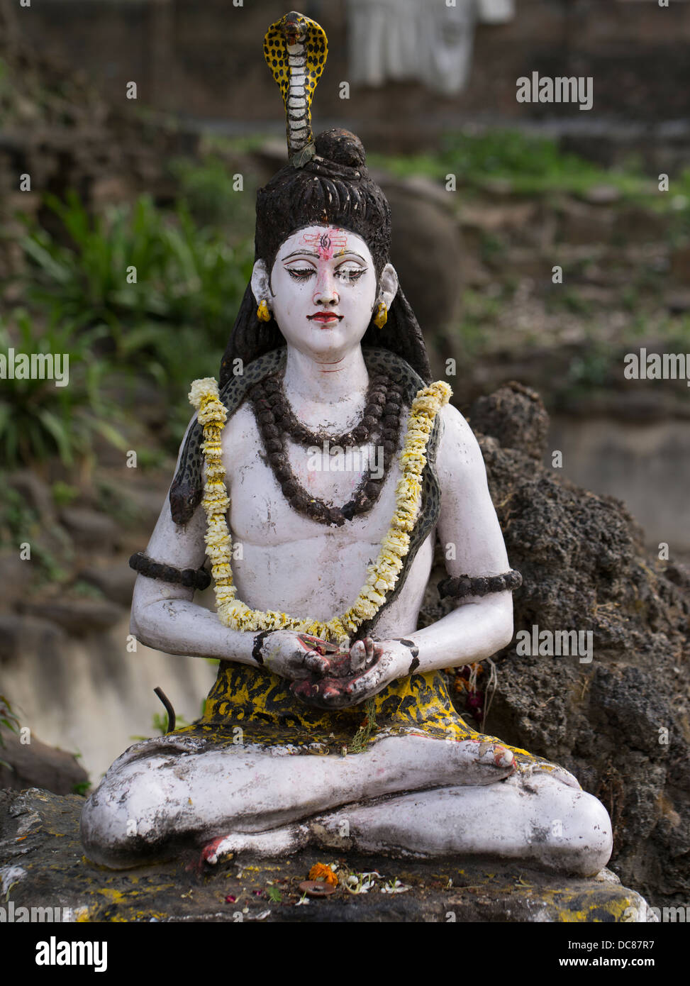 Statue of Lord Shiva, Hindu Deity - Life on the banks of the Ganges River - Varanasi, India - Stock Image